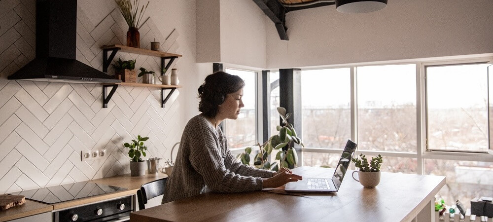 woman using kitchen as an office
